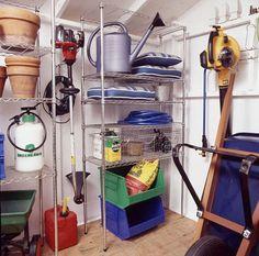 Gardening tools organized onto shelves