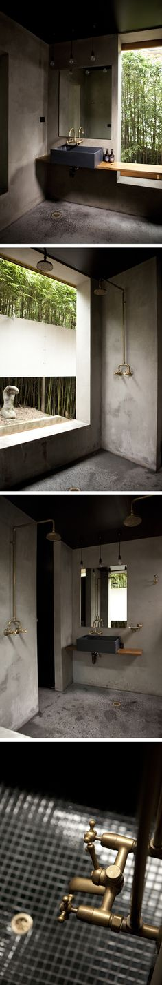 dark and moody contemporary bathroom with brass faucet.