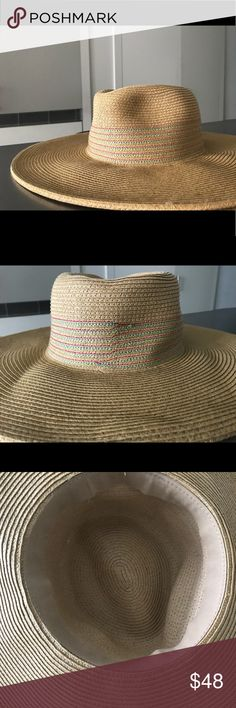 NWOT Handmade in Mexico Wide Brim Straw Hat Similar size to the Lack of Color wide brim fedora, this straw hat is very flattering and offers a lot of sun protection. You can shape the top to have dimples like a fedora or keep it straight like a boater hat.  I just bought it two days before Easter 2018 in Mexico but did not wear it due to wind and grey skies. The hat has pink and teal stitch detail with unnoticeable seam in the back (as pictured).  Tagged Lack of a Color for exposure Lack of…