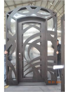 All of our doors are custom built to your exact dimensions. Please provide desired width and height for a free quote. Main Entrance Door Design, Door Gate Design, Fence Design, Exterior Doors With Sidelights, Modern Front Door, Wrought Iron Doors, House Front Design, Iron Gates, Steel Doors
