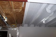 Industrial Look Basement Ceiling Painting. Instead of drywall or drop ceiling, paint it all with an Airless Sprayer in white to make it uniform but blend in and bright.