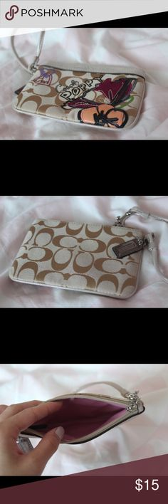 Coach Poppy Wrist Wallet It's been only used a few times but still in great condition. It's a really cute wrist wallet with the poppy design on it. Bags Wallets