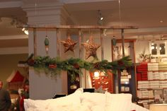 barn ladder decor... Love this idea in Pottery Barn of using an old ladder suspended from ceiling..makes a cute headboard......