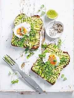 Smashed avocado toast with soft-boiled egg.