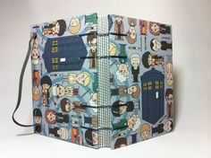 Tardis and Incarnations of the Doctor - Dr Who Fabric Handmade Journal Notebook - Coptic Stitched. via Etsy.