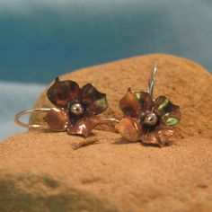 Hey, I found this really awesome Etsy listing at https://www.etsy.com/listing/79188986/copper-flower-earring-silver-mixed-metal