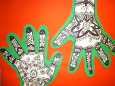 Henna Hands! Loved using this with our Ancient India unit. We did one guided hand and the other the kids did on their own with papers showing ideas for designs. We didn't have time to double mount on green or orange, but they still look great! I will do this every year!