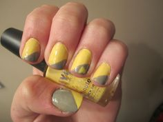 Both NYC colors. Yellow and Grey nails with a little heart on the ring finger, I think they're cute :)