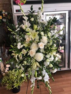 Brantford Blooms Florist offers unique arrangements for any occasion. With same-day day delivery, your flowers will surely brighten someone's day. Blooms Florist, Funeral, Flower Arrangements, Congratulations, Floral Wreath, Birthdays, Wreaths, Flowers, Green