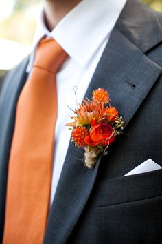 Orange ranunculus, mini orange dahlia buds, and orange globe amaranthus, mixed with angel vine