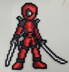 Deadpool perler beads by Rusted Icon Designs Hama Beads Patterns, Beading Patterns, Art Deadpool, Pixel Art, Perler Bead Templates, Nerd Crafts, Peler Beads, Melting Beads, Perler Bead Art