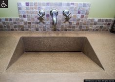 Our Most Versatile Design, Ramp Sinks slope to order!Front, back, side, center ramps, all with great possibilities for color coordination. Faucet placement and countertop are to spec. With this enigmatic creation, water flows down the ramp and vanishes into an obscured slot drain, no visible hardware. In EarthCrete™ concrete, lighter, stronger, more colorful, sustainable and UN-stainable! IAPMO-listed, can be ADA-complaint. On cabinetry or floated between walls, natural or designer colors.