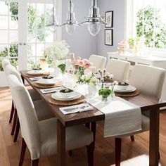 A dining area with a brown dining table combined with dining chairs, and a table runner
