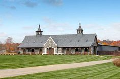 This multi-stall horse barn and indoor arena incorporates natural light and plenty of windows for enhanced airflow Horse Barn Plans, Barn Stalls, Farm Barn, Horse Stables, Horse Farms, Indoor Arena, House Painting, Tack Rooms, Barn Apartment