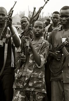 Twelve year old soldier, South Sudan, 2009, by Giles Duley