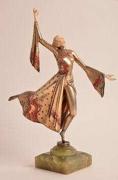 Gerda Ira Gerdago (Austrian:1906-2004). Danseuse, A cold painted bronze and carved ivory figure of a female dancer with her arms outreached. Mounted on a green onyx base. Signed Gerdago with a foundry mark.  Height of figure 11 inches. Overall height 121/2