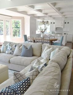 ideas for how to style and decorate a sectional sofa or couch with toss cushions. Living room Decor ideas