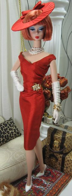 Quite chic in red and long gloves.