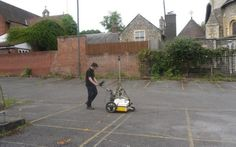 Investigators use a ground penetrating radar to examine the land beneath a car park in Reading