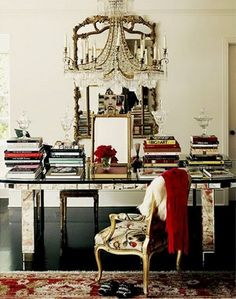 Books + table + chandelier + chair + rug --all gorgeous.