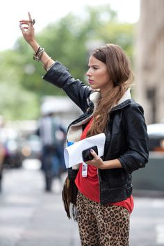 Layered wrist & black jacket & pop of color & leopard pants.