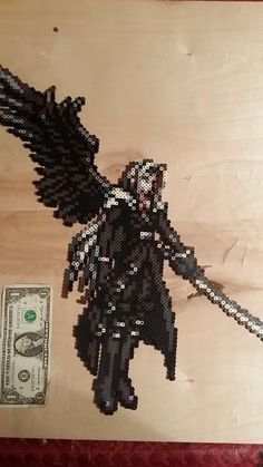Made Sephiroth from FF Record Keeper. You now have his song stuck in your head.