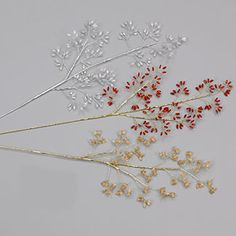 "Metallic gold or silver wire branches with        acrylic rice beads.  (Note: color ""C"" is clear    beads with gold branch, color ""S"" is clear beads  with silver branch).  Length: 19"""