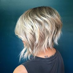 Textured bob with a shadowed root .
