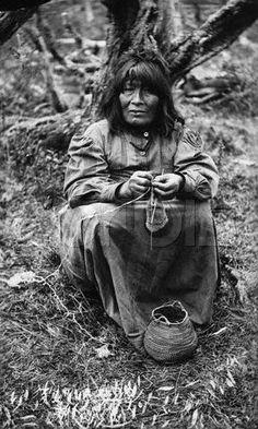ca. 1930, Magallanes y Antartica Chilena Region, Chile --- Native American Woman Near Cape Horn --- Image by ? Hulton-Deutsch Collection/CORBIS