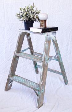 A rustic wooden step ladder with wonderful patina, perfect for the farmhouse look! Use this step stool to display a collection, as an end table, or as a functional step stool. Either way, it will look great. I have several of these in my house and they are perfect and I can always reach in the top cupboards! Vintage Wood, Vintage Home Decor, Vintage Industrial, Rustic Side Table, Wooden Steps, Shabby Look, Wood Stool, Industrial House, Wall Sculptures