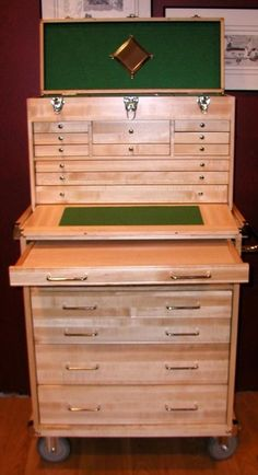 tool chest - this looks to me like a wooden version of the tool box my grandpa used... Very beautiful...