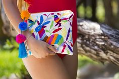 The Camila Otomi pouch, authentic Mexican embroidery in this bright and beautiful little bag. Pom pom fun! Choose artisan, join the slow fashion revolution!
