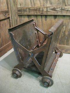 Vintage Industrial Cast Iron Magazine Rack On Wheels