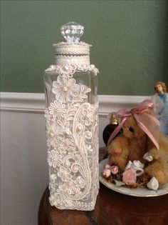 DIY Altered bottle. Lovely lace bottle crafted by Juana Hudson.
