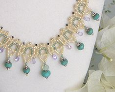 The drama of pattern, dramatic beaded cooper and peach pearl collar necklace with lustrous metallic crystals  - Materials: seed beads, Swarovski crystals and Swarovski pearls - Color: metallic copper, pearl rose gold, gunmetal grey - Size 14 or 36 cm, custom length available - Style number 524 - All my creations are completely handmade with love  Matching earrings (not included) https://www.etsy.com/il-en/listing/231411045/bead-weaving-earrings-copper-gunmetal?re...