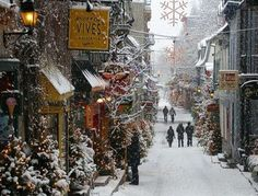 magicalplacetobe: Quebec City, in the province of Quebec, Canada.(contentinacottage.blogspot.com)  wow!! this looks like Diagon Alley in winter :) how pretty!! i can imagine that guy is actually Harry looking into the window where the firebolt is displayed ;)