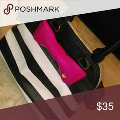 BETSEY JOHNSON small crossbody dome purse Black and white with HOT PINK bow. Made by Betsey Johnson and brand new. does not come with tags. It's small and perfect crossbody bag. The logo is still wrapped in plastic. Perfect bag for carrying few essentials and adding a pop of color. Betsey Johnson Bags Crossbody Bags