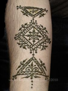 Henna on a man's arm! It has a rural finish to it, very beautiful