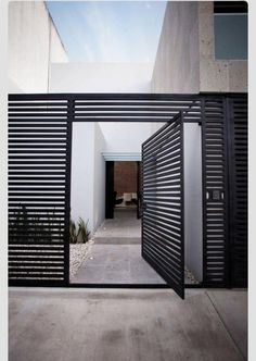 Awesome Volume House of Cereza 20 by Warm Architects in Cancun: Beautiful Cereza Home Design Exterior With Modern Welcome Gate Used Black Door Design Ideas And Concrete Flooring Style ~ SFXit Design Architecture Inspiration Front Door Design, Entrance Design, House Entrance, Main Entrance, Modern Entrance Door, Garden Entrance, Design Entrée, House Design, Design Ideas