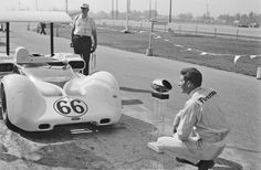 At Riverside, Jim Hall poses with his Chaparral 2E (2E-001) and the 1966 Can-Am Trophy. Chaparral would never win the Can-Am trophy, and 1966 was the closest they came. Al Bochroch photo.