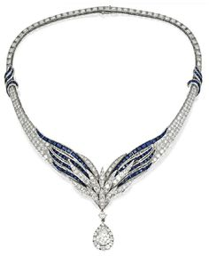PLATINUM, SAPPHIRE AND DIAMOND NECKLACE BY E. PEARL. Photo via Sotheby's.