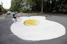 A suburb of Vancouver has a creative take on making their streets safer for pedestrians and cyclists-- a mural of a giant fried egg! This #LQC community-led, ultra-light intervention is  a powerful tool for traffic calming. How 'egg'cellent! #Placemaking #StreetsAsPlaces