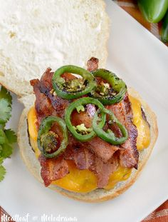 jalapeno bacon cheddar burgers with bbq sauce on plate