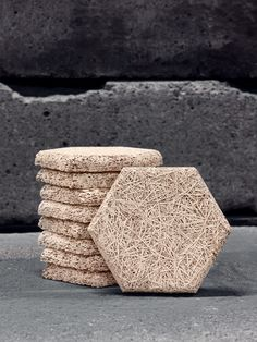 Swedish company Träullit produce Dekor Tiles from an environmentally-friendly recyclable material, made from 'wood-wool', cement & water. This combination of natural components is simple & clever. Wood fibres make the tiles sound-absorbent & give the product a heat-insulating, heat-retaining quality. This contributes to lower energy costs, reducing environmental impact. Cement provides strength, moisture resistance & fire protection.  http://www.traullit.se/product/produkter/traullit-dekor/