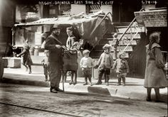 STREET LIFE: Organ Grinder. East Side, NYC. The portable organ and it's grinder were a passing amusement in the working class neighborhoods and commercial areas. Music lovers detested their music. The grinder played for pennies. Mostly men, they were without labor and often of ill-repute. 1910