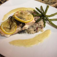 This is my lemon dill an white wine baked salmon with braised asparagus and shallot and garlic risotto with cream sauce