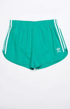 Infuse your summer style with a throwback-inspired adidas look. The adicolor Track Shorts have a dolphin-style hem, a comfortable elasticized waist, and a tonal stripes design with iconic adidas branding.    Tonal striped shorts  adidas Trefoil graphic near hem  3-Stripes detailing  Dolphin hem  Elasticized waist  Machine washable