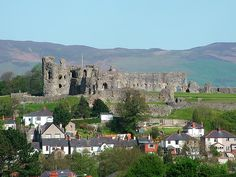 Denbigh Castle was a fortress built following the 13th-century conquest of Wales by Edward I. The castle stands on a rocky promontory above the Welsh market town of Denbigh, Denbighshire.