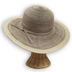 """Versatile and lightweight classic women's sun hat with UPF 50 protection can be dressed up or down. The wide 4"""" brim is sun protective and chic."""