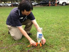 Setting up a water rocket by Fizzics Education. #fizzics #scicomm #scied #outdoors #education www.fizzicseducation.com.au